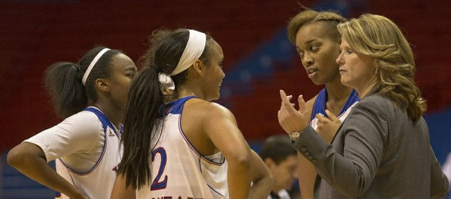 Kansas head coach Bonnie Henrickson talks to her players during a time out in their game against Texas Southern, Thursday at Allen Fieldhouse. The Jayhawks won, 105-78, and will next face Purdue on Dec. 15 at home.