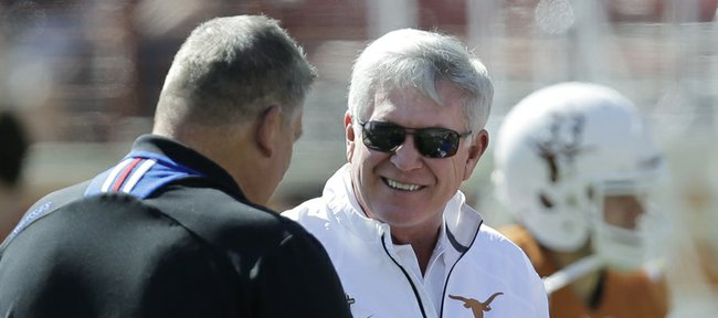 Kansas coach Charlie Weis, left, and Texas coach Mack Brown visit prior to their Nov. 2 game in Austin, Texas.