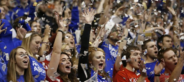 Confetti flies in the south endzone as the Jayhawks' starting five are announced prior to tipoff against Towson on Friday, Nov. 22, 2013 at Allen Fieldhouse.