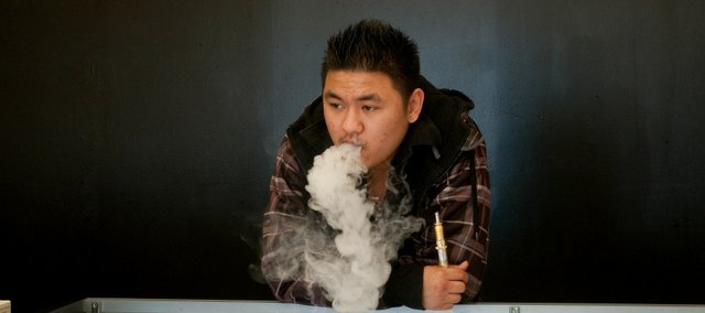 Jack Tran, owner of Lawrence electronic cigarette store Juice-E-Vapes, said he used the devices to kick his own smoking habit.
