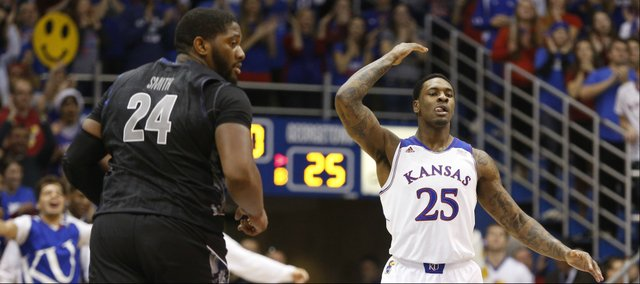 Kansas forward Tarik Black raises the Fieldhouse after throwing down a lob dunk against Georgetown during the first half on Saturday, Dec. 21, 2013.