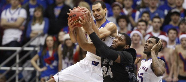 Kansas forward Perry Ellis competes for a rebound with Georgetown center Josh Smith and teammate Tarik Black during the first half on Saturday, Dec. 21, 2013 at Allen Fieldhouse.