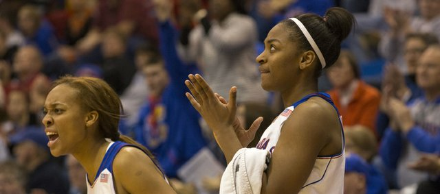 Kansas reserves Caelynn Manning-Allen, left, and Bunny Williams cheer from the bench late in the second half of their game against Tulsa, Sunday afternoon at Allen Fieldhouse. The Jayhawks won, 82-78, and will next face Yale on Dec. 29. 2013 in Lawrence.