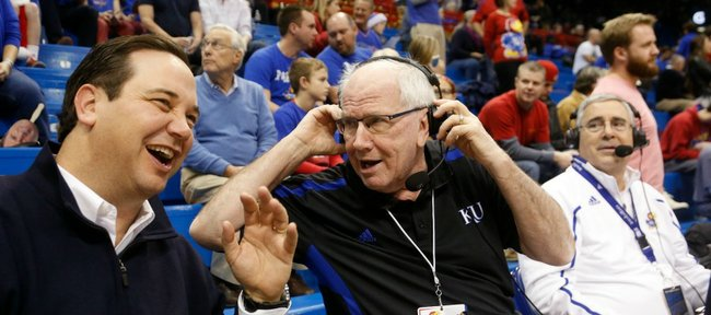 Radio broadcaster Bob Davis gets into conversation with color commentator Greg Gurley prior to the Jayhawks' tipoff against Georgetown on Saturday, Dec. 21, 2013 at Allen Fieldhouse. Davis is in his 30th year of broadcasting Kansas basketball games. At right is technician Bob Newton.