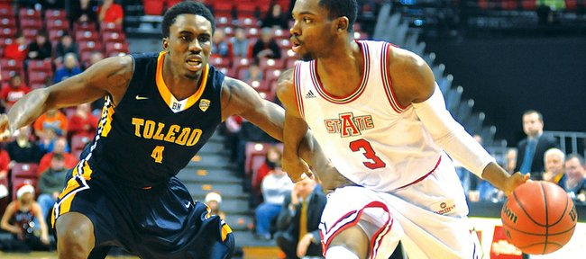 Arkansas State's Brandon Reed (3) drives past Toledo's Justin Drummond during the second half of an NCAA college basketball game Tuesday, Dec. 17, 2013 at The Convocation Center in Jonesboro, Ark. Toledo defeated Arkansas State 78-65. (AP Photo/The Jonesboro Sun, Rob Holt)