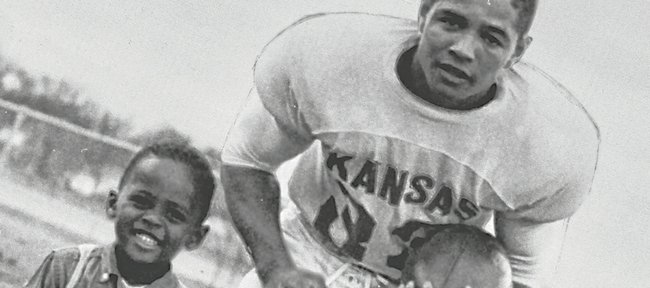 Former Kansas University football player Homer Floyd, right, and oldest son J.C. pose during Homer's standout KU career. Floyd, who was a co-captain and led KU in rushing and tackles several times from 1956 to 1958, dedicated his post-KU career to promoting civil rights.