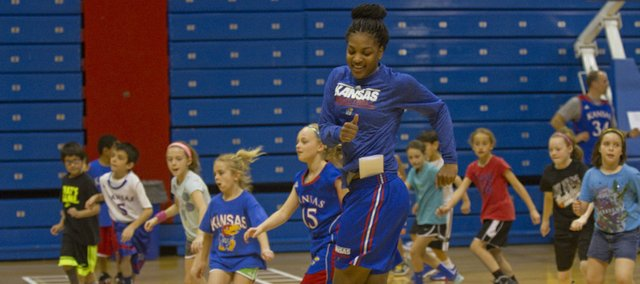 Kansas University's Bunny Williams leads a drill with a group of young fans during the KU women's annual holiday hoops clinic, Friday, Dec. 27, 2013, at Allen Fieldhouse.