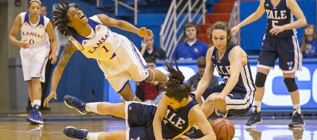 Kansas sophomore guard Lamaria Cole (1) falls as she is undercut by Yale's Sarah Halejian as they scramble for a loose ball along with Hayden Latham, right, during their game, Sunday, Dec. 29, 2013, at Allen Fieldhouse.