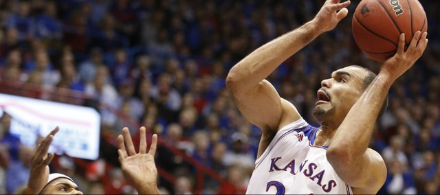Kansas forward Perry Ellis goes to the hoop against Toledo forward J.D. Weatherspoon during the first half on Monday, Dec. 30, 2013 at Allen Fieldhouse.