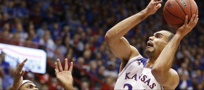 Kansas forward Perry Ellis goes to the hoop against Toledo forw
