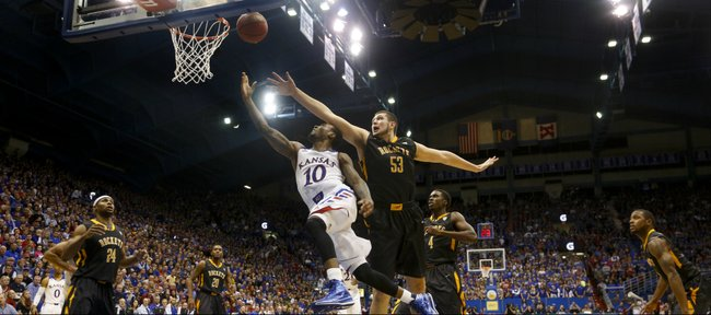 Kansas guard Naadir Tharpe glides under Toledo center Nathan Boothe for a bucket du