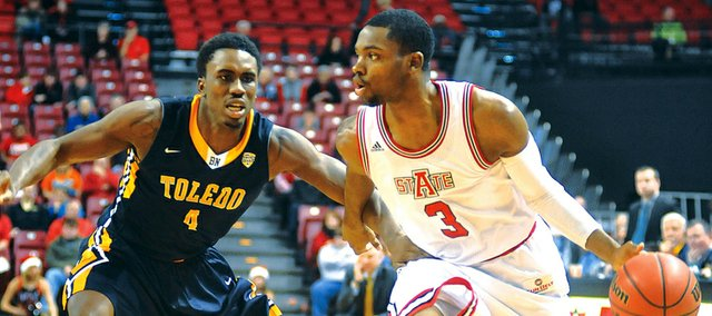 Arkansas State's Brandon Reed (3) drives past Toledo's Justin Drummond during the second half of an NCAA college basketball game Tuesday, Dec. 17, 2013 at The Convocation Center in Jonesboro, Ark. Toledo defeated Arkansas State 78-65.