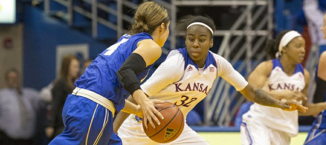 Kansas freshman guard Keyla Morgan (32) pressures Tulsa guard Erika Lane (4) during their game Sunday afternoon at Allen Fieldhouse. The Jayhawks won, 82-78, and will next face Yale on Dec. 29. 2013 in Lawrence.