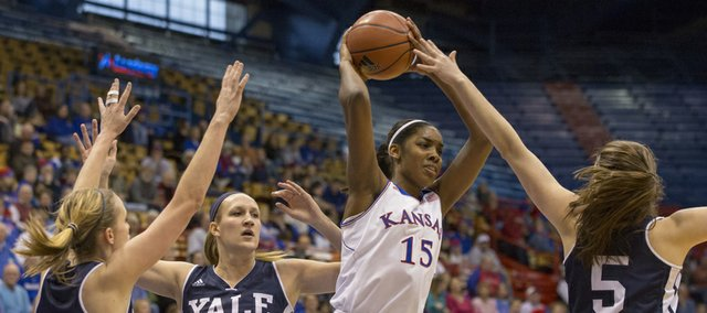 Kansas junior forward Chelsea Gardner (15) looks for a teammate as a Yale triple team by Janna Graf (34), Emmy Allen (3) and Katie Werner (5) collapses around her during their game, Sunday at Allen Fieldhouse.
