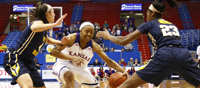 Kansas University's CeCe Harper (24) works against West Virginia's Brooke Hampton (4) and Bria Holmes (23) during their game, Thursday, Jan. 2, 2014, at Allen Fieldhouse. West Virginia won, 65-55, in the Big 12 Conference opener for both teams.