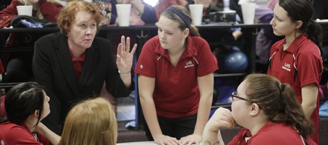 Lawrence High bowling coach Paula Bastemeyer talks to the team between games during the Free State high school Invitational bowling tournament Saturday at Royal Crest Lanes