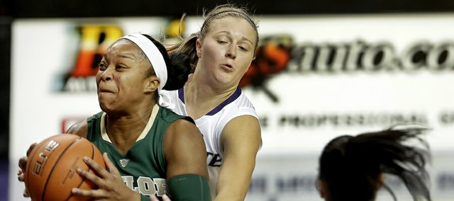 Baylor's Odyssey Sims (0) gets past Kindred Wesemann, center, and Leticia Romero (10) to put up a shot during the second half of an NCAA college basketball game Thursday, Jan. 2, 2014, in Manhattan, Kan. Sims scored 40 points leading Baylor to a 92-63 win. (AP Photo/Charlie Riedel)