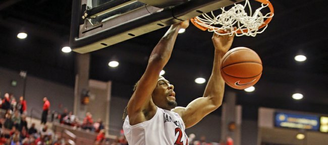 San Diego State forward Josh Davis slams home a basket against McNeese State during the second half of San Diego State's 65-36 victory in an NCAA college basketball game in San Diego, Saturday, Dec. 21, 2013. (AP Photo/Lenny Ignelzi)