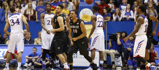 San Diego State players Aqeel Quinn (10) and JJ O'Brien celebrate the Aztecs 61-57 victory over the Jayhawks as time expires on Sunday, Jan. 5, 2013 at Allen Fieldhouse.