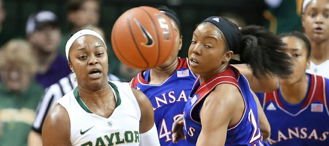 Kansas guard CeCe Harper, right, and Baylor guard Odyssey Sims eye a possession in the Bears' 75-55 victory Sunday in Waco, Texas.
