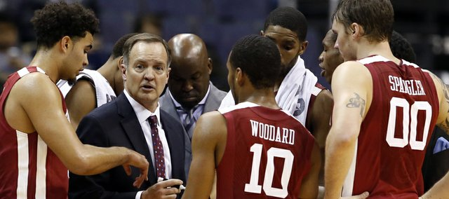 Oklahoma head coach Lon Kruger talks to his team during a timeout in the second half of an NCAA college basketball game in the BB&T Classic against George Mason, Sunday, Dec. 8, 2013, in Washington. Oklahoma won 81-66. (AP Photo/Alex Brandon)
