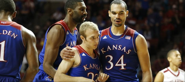 Kansas forwards Perry Ellis (34) and Justin Wesley celebrate a late three by Kansas guard Conner Frankamp (23) against Oklahoma during the first half on Wednesday, Jan. 8, 2013 at Lloyd Noble Center in Norman, Oklahoma.