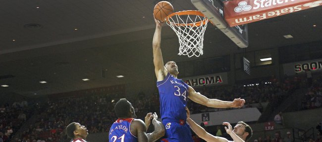 Kansas forward Perry Ellis delivers a dunk over the Oklahoma defense during the first half on Wednesday, Jan. 8, 2013 at Lloyd Noble Center in Norman, Oklahoma.