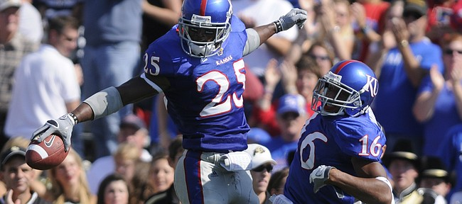 Kansas safety Darrell Stuckey celebrates with cornerback Chris Harris after Stuckey's interception of Colorado quarterback Cody Hawkins during the second quarter Saturday, Oct. 11, 2008 at Memorial Stadium.