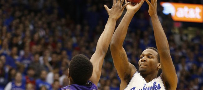 Kansas guard Wayne Selden puts a shot over Kansas State guard Wesley Iwundu during the first half on Saturday, Jan. 11, 2014 at Allen Fieldhouse.