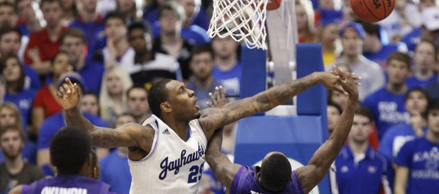 Kansas forward Tarik Black rejects a shot from Kansas State guard Jevon Thomas during the second half on Saturday, Jan. 11, 2014 at Allen Fieldhouse.
