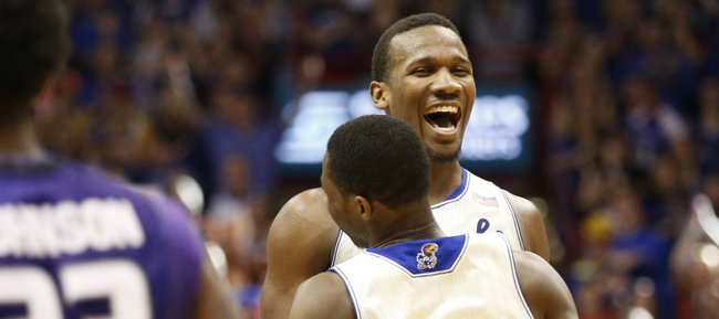 Kansas teammates Wayne Selden and Andrew Wiggins (22) celebrates Wiggins' dunk against Kansas State during the second half on Saturday, Jan. 11, 2014 at Allen Fieldhouse.