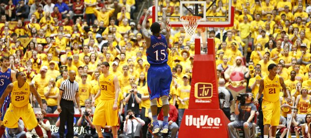 Kansas guard Elijah Johnson pulls up from the top of the key for a three-pointer against Iowa State during overtime on Monday, Feb. 25, 2013 at Hilton Coliseum in Ames, Iowa.
