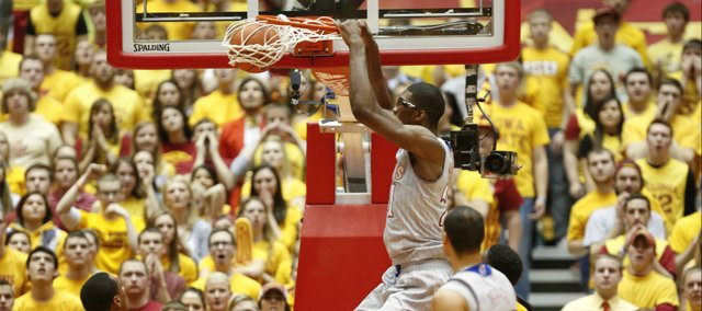 Kansas center Joel Embiid delivers a dunk against Iowa State during the first half on Monday, Jan. 13, 2014 at Hilton Coliseum in Ames, Iowa.