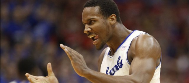Kansas guard Wayne Selden gets pumped after a Jayhawk dunk against Oklahoma State during the first half on Saturday, Jan. 18, 2014 at Allen Fieldhouse.