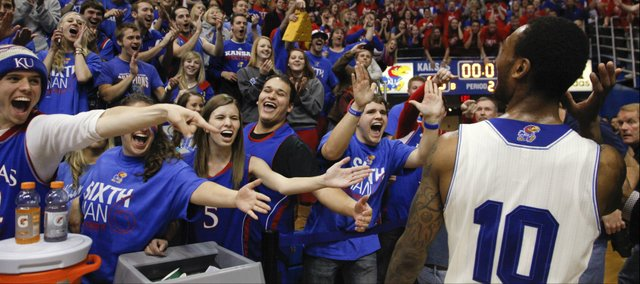 Kansas guard Naadir Tharpe holds his hand up to his ear to better hear the roar of the fieldhouse as he leaves the floor following the Jayhawks' 80-78 win over Oklahoma State on Saturday, Jan. 18, 2014 at Allen Fieldhouse.