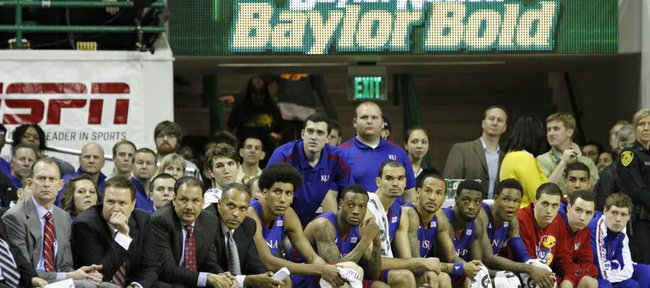 The KU bench watches the final seconds of KU's 81-58 loss to the Baylor Bears Saturday in Waco.