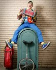 Lawrence busker Richard Renner has been known to juggle, play an accordion, and ride a unicyle. Renner is the creator of the Lawrence Busker Festival.