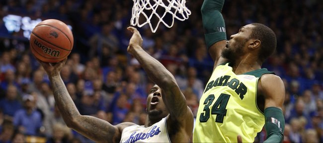 Kansas forward Jamari Traylor maneuvers for a bucket against Baylor forward Cory Jefferson during the first half on Monday, Jan. 20, 2014 at Allen Fieldhouse.