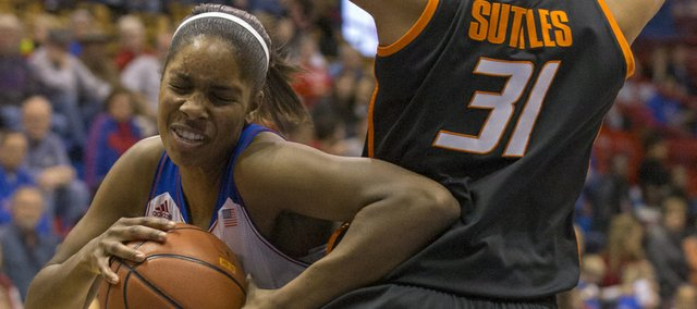 Kansas junior forward Chelsea Gardner uses her elbow to hook Oklahoma State senior center Kendra Suttles (31) as she makes a move to the basket during their game, Wednesday at Allen Fieldhouse.