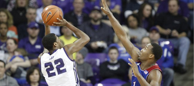 Kansas guard Wayne Selden reaches to defend against a shot from TCU guard Jarvis Ray during the second half on Saturday, Jan. 25, 2014 at Daniel-Meyer Coliseum in Fort W