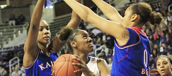 Kansas' Chelsea Gardner (15) and Asia Boyd (0) defend against KSU's Breanna Lewis on Saturday, Jan. 25, 2014, in Manhattan.