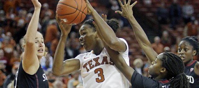 Texas forward Nneka Enemkpali (3) goes up for a shot against Stanford forward Mikaela Ruef, left, and guard Lili Thompson, right, during the first half of an NCAA college basketball game Saturday, Nov. 23, 2013, in Austin, Texas. (AP Photo/Michael Thomas)