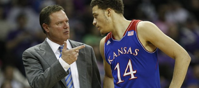 Kansas head coach Bill Self talks with guard Brannen Greene during a break in action against TCU on Saturday, Jan. 25, 2014 at Da