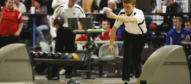 Free State sophomore Avery Allen bowls during the Firebirds' quad on Tuesday, Jan. 28, 2014, at Royal Crest Lanes.