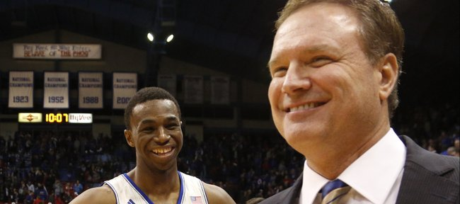 Kansas guard Andrew Wiggins smiles with head coach Bill Self as the two wait for an interview with ESPN following the Jayhawks 92-81 win over on Wednesday, Jan. 29, 2014 at Allen Fieldhouse.