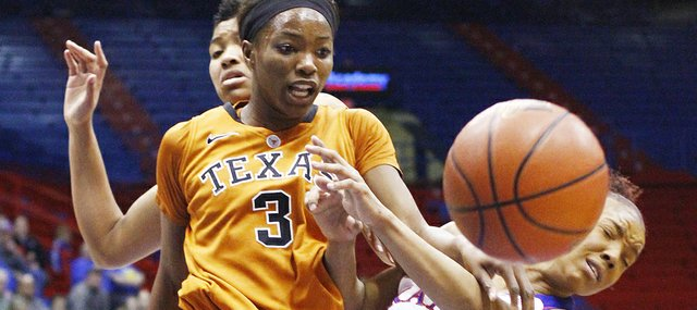 Kansas University guard Cece Harper (24) fights for a rebound against Texas' Nneka Enemkpali (3) in the first half on Tuesday, Jan. 28, 2014, at Allen Fieldhouse. The Jayhawks lost to the Longhorns for the second time this season, 80-55.