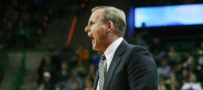 Texas coach Rick Barnes argues a call against Baylor in the second half of UT's game Saturday in Waco, Texas. Texas has won five straight Big 12 games heading into today's meeting with Kansas University.