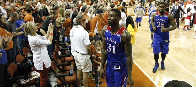 Kansas forward Jamari Traylor is followed by teammate Tarik Black as the Jayhawks leave the floor after their 81-69 loss to Texas on Saturday, Feb. 1, 2014 at Erwin Center in Austin, Texas.