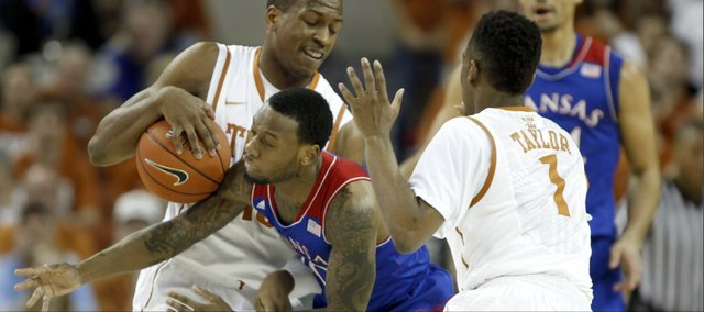 Kansas guard Naadir Tharpe misses going for a steal from Texas forward Jonathan Holmes during the first half on Saturday, Feb. 1, 2014 at Erwin Center in Austin, Texas. Also pictured is Texas guard Isaiah Taylor.
