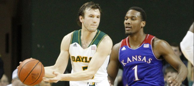 Kansas guard Wayne Selden (1) defends Baylor guard Brady Heslip (5) tight during the second half of the Jayhawks' 69-52 win over the Bears Tuesday, Feb. 4, 2014 at Ferrell Center in Waco, Texas.